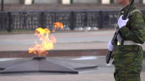Memorial fire and armed soldier. Super slow motion long shot. Eternal flame memorial and armed guard. Super slow motion video stock video