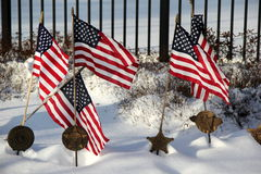 Memorial flags and grave markers in snow stock image