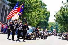 Memorial Homecoming Parade for Soldier Killed in Action. An honor guard of local firefighters and police officers lead a procession including over 1,000 Patriot royalty free stock photos