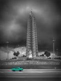 Memorial a Jose Marti with green car, Havanna. Memorial a Jose Marti with green car, black-white background, Havanna royalty free stock image