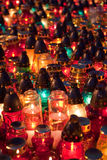 Memorial lampions at the cemetery. Memorial candles shining at the cemetery on the All Saints Day Day (November 1st Royalty Free Stock Photos
