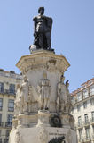 Memorial monument to the poet Camoes. Monumental statue of 16th century epic poet Camoes standing on a pedestal with other smaller statues of classical Stock Image