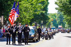 Memorial Parade for U.S. Soldier Killed in Action. An honor guard of local firefighters and police officers lead a procession including over 1,000 Patriot Guard royalty free stock photography