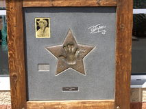 Memorial plaque of Ian Tyson. On entrance of Tim Hortons restaurant in Merritt, Canada on July 24, 2011.Ian Tyson is a Canadian singer-songwriter of the Stock Images