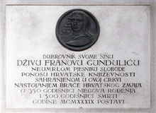 Memorial Plaque to Ivan Gundulic buried in the Franciscan church in Dubrovnik. Memorial Plaque to Ivan Gundulic buried in the Franciscan church of the Friars stock images