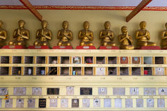 Memorial Plaques Mounted on a Wall inside Buddhist temple Stock Image