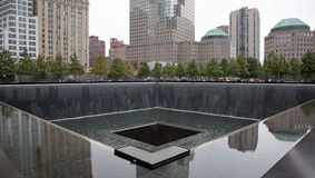 911 Memorial Pool in NYC. With crowd of views and reflections Royalty Free Stock Photos