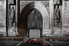 Memorial with poppies outside Bath Abbey, at night Royalty Free Stock Photos