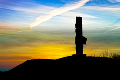 Memorial silhouetted against the sunset Stock Photography