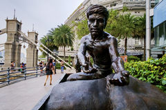 The memorial statue known as `Coolies`. Boat, Clarke, Robertson Quays, Singapore - November 1, 2016: The memorials known as Coolies of those early eighteen Royalty Free Stock Image
