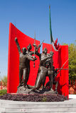 Memorial statue in Monterrey, Mexico. Memorial statue at entrance to Parque Ninos Heroes, Monterrey, Mexico. Bronze soldier figures with flag and rifles against royalty free stock images