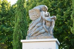 Memorial statue in Roncade, Treviso. An angel in stone is holding a victim in its arms. It is a memorial for the victims in the first word war Royalty Free Stock Photo