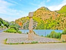 Memorial stone lake Cuber reservoir in the Serra de Tramuntana, Majorca, Spain Royalty Free Stock Photo