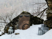 Memorial stone of Slovak mountaineer on peak in winter forest royalty free stock photography