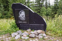 Memorial stone to the famouse Russian writer Mamin Sibiryak. Village Visim, Russia. Stock Photography
