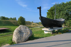 Memorial stone and Viking boat near the Belozersk Kremlin Stock Photos