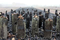 Memorial stones at Buchenwald site, Germany. Black basalt steles on a small elevation form the memorial to the Sinti and Romani victims at the site of Block 14 Royalty Free Stock Images