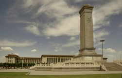 Memorial in Tiananmen Square. Tiananmen Square in Beijing China Blue sky with clouds WS Government offices in bkg Royalty Free Stock Images