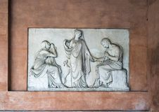 Memorial to Clelia Severini, a neo-Classical carved relief embedded in a wall in the narthex of San Lorenzo in Lucina Stock Photography