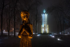 Memorial to Holodomor victims - Kiev. Memorial to Holodomor victims in Kiev (Ukraine). Illuminated girl's sculpture is surrounded with frosted trees. Holodomor ( Royalty Free Stock Images