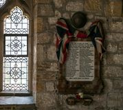 Memorial to lost soldiers in World War 1. British Army helmet and Union Jack flag royalty free stock photo
