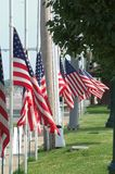 Memorial to President Reagan. Several flags lining a public square flying half mast in honor of President Reagan's death Royalty Free Stock Image