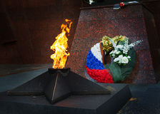 Memorial to tomb of soldiers died in WWII in Zvenigorod, Russia. Eternal Flame Stock Photos