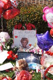 Memorial to Whitney Houston. Photograph of Whitney Houston, flowers, cards, letters and balloons left in front of the Beverly Hilton Hotel in Beverly Hills Royalty Free Stock Photography