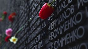 Memorial wall with names of Soviet soldiers of Great Patriotic War. Memorial wall with the names of Soviet soldiers who died during the Great Patriotic War. Red stock footage
