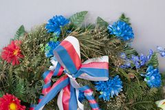 Memorial wreath with ribbon - tricolor of blue, red, white color. Decoration for celebration of Czech nation of Czech republic / Czechia royalty free stock photos