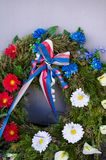 Memorial wreath with ribbon. Tricolor of blue, red, white color. Decoration for celebration of Czech nation of Czech republic / Czechia. Very low depth of royalty free stock photo