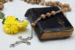 In memoriam. Rosary and old psalmody with yellow autumnal flower Royalty Free Stock Images