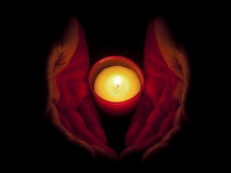 In memoriam - candle with hands stock image