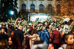 In memoriam of death of King Mihai of Romania. BUCHAREST, ROMANIA - 14 DECEMBER 2017: People gathered to bring flowers as the last homage in memory of King Mihai stock image