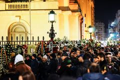 In memoriam of death of King Mihai of Romania. BUCHAREST, ROMANIA - 14 DECEMBER 2017: People gathered to bring flowers as the last homage in memory of King Mihai royalty free stock photos