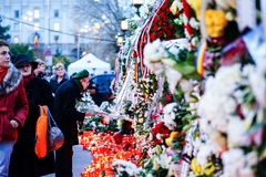 In memoriam of death of King Mihai of Romania. BUCHAREST, ROMANIA - 15 DECEMBER 2017: People gathered to bring flowers as the last homage in memory of King Mihai royalty free stock photo
