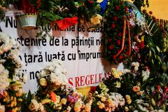 In memoriam of death of King Mihai of Romania. BUCHAREST, ROMANIA - 14 DECEMBER 2017: People gathered to bring flowers as the last homage in memory of King Mihai stock photos