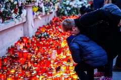 In memoriam of death of King Mihai of Romania. BUCHAREST, ROMANIA - 15 DECEMBER 2017: People gathered to bring flowers as the last homage in memory of King Mihai royalty free stock images