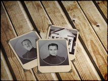 Memories. Three old photos on wooden boards stock photo