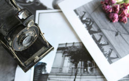 Memories. Photographic camera against black and white pictures and flowers Stock Photo