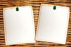 Memories. Clean paper sheets attached to the wooden background Royalty Free Stock Images