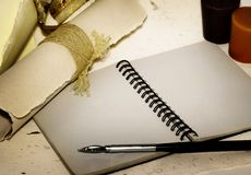 Memories. Retro style notebook with old pen, stylish papers, candle Royalty Free Stock Images