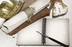 Memories. Retro style notebook with old pen, stylish papers, heart, old distroyed book Stock Photography
