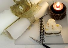 Memories. Retro style notebook with old pen, stylish papers, candle and heart Royalty Free Stock Photography