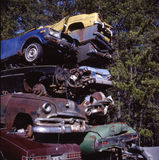 Memories. Pile of scrapped vintage cars Royalty Free Stock Photos