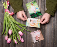Memories concept, mother's day. Family photos in man hands and stock image