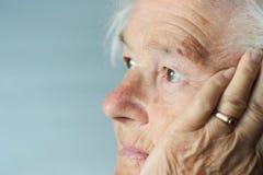 Memories of the senior woman. Elderly woman brings back memories Stock Photos