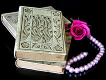 Memories of Someone I Loved. White, 100 year old hard cover books, modern pearls and a rose. Books show their age, some dirt and tattered pages. The soft pink Royalty Free Stock Images