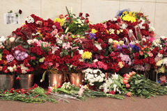 Memories the victim at acts of terrorism. MOSCOW, RUSSIA - MAR 29: Natural flowers in the Moscow underground at station Lubyanka in an anniversary of memory of stock photos