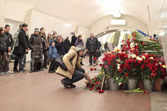 Memories the victim at acts of terrorism. MOSCOW, RUSSIA - MAR 29: Natural flowers in the Moscow underground at station Lubyanka in an anniversary of memory of stock photography
